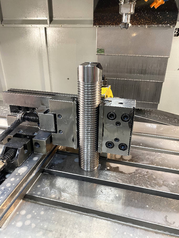 Custom CNC machining of an industrial part.